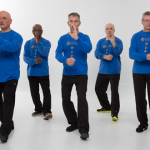Tai Chi Club students perform fist under the elbow